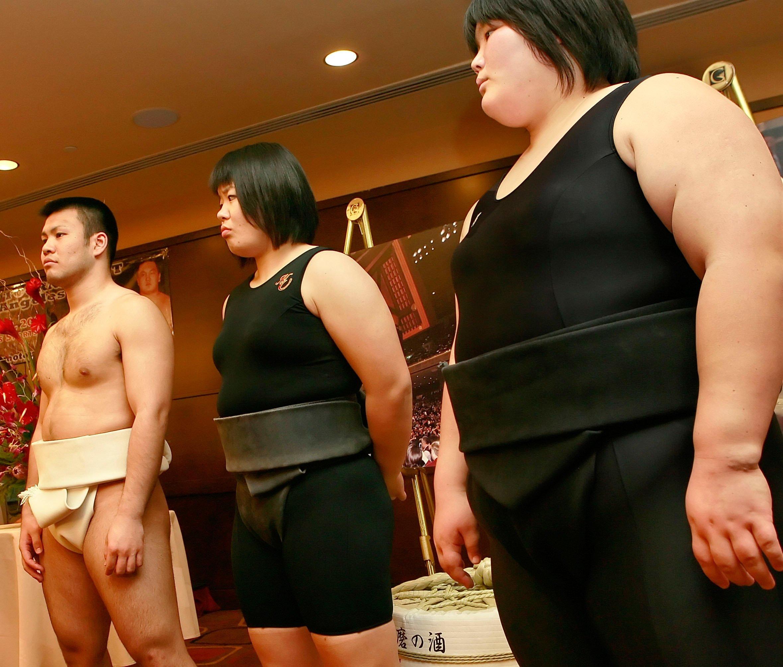 Fukushima, Japan - Female sumo wrestlers engage in a match