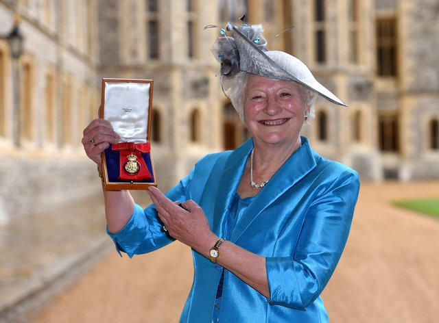 Dame Mary Peters holds her insignia of member of the Order of the Companions of Honour services to sport at Windsor Castle (PA Images)