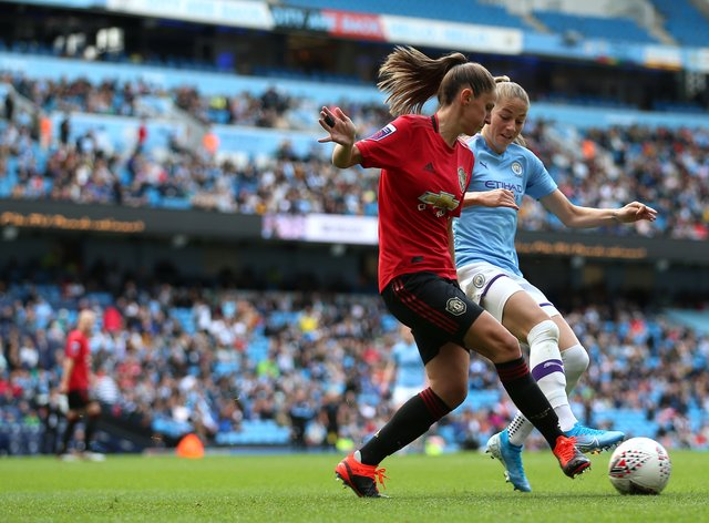 Man United's Abbie McManus battles for the ball against City's Janine Beckie (PA Images)