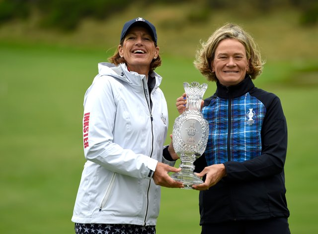 Team USA captain Juli Inkster (left) poses with the Solheim Cup trophy alongside Team Europe captain Catriona Matthew (PA Images)