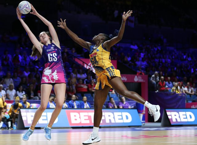 Emma Barrie, left during the Summer's Netball World Cup in Liverpool (PA Images)