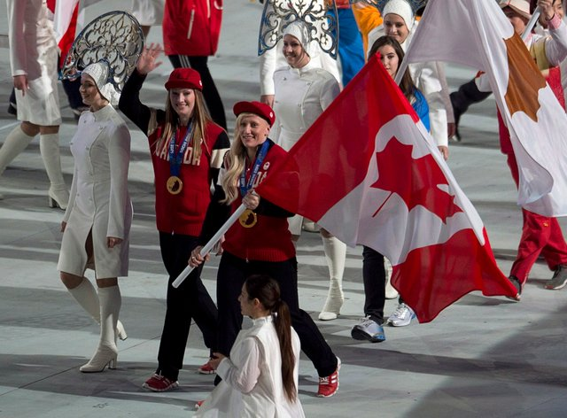 Humphries (right) and Heather Moyes carried the Canadian flag at the Sochi closing ceremony (PA Images)