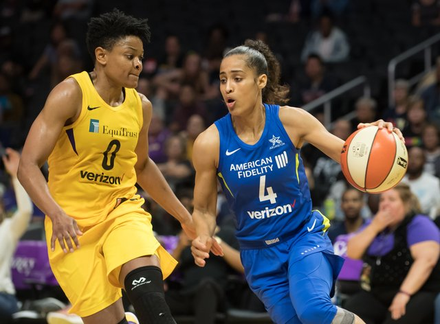 Skylar Diggins-Smith (right) played the 2018 season while pregnant (PA Images)
