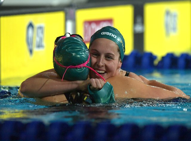 Minna Atherton receives a congratulatory hug from Canada's Sydney Pickrem (PA Images)