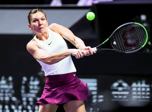Simona Halep showed little sign of the back injury that has plagued the latter part of her season (PA Images)