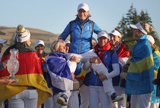 Team Europe celebrate their victory by hoisting captain Catriona Matthew onto their shoulders (PA Images)