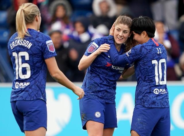 Mjelde (centre) celebrates scoring Chelsea's crucial second goal (PA Images)