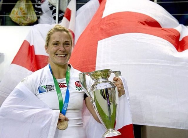 Burford with the World Cup trophy in 2014 (Instagram: Rachael Burford)
