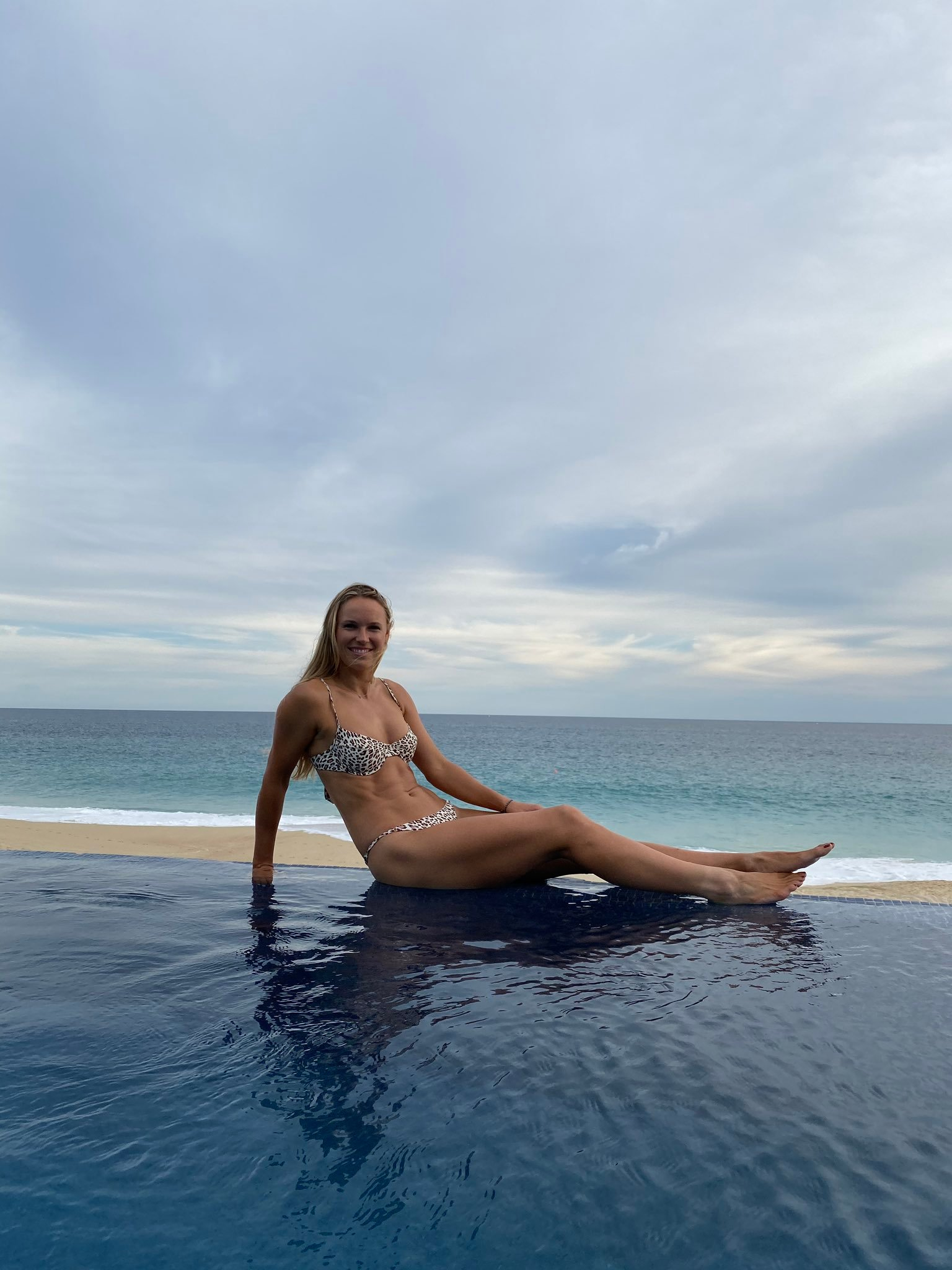 Caroline Wozniacki poses for Sports Illustrated photoshoot shortly after announcing retirement from tennis