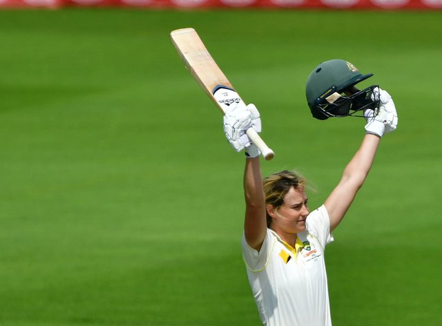 Perry celebrates reaching one hundred in the Women's Ashes (PA Images)