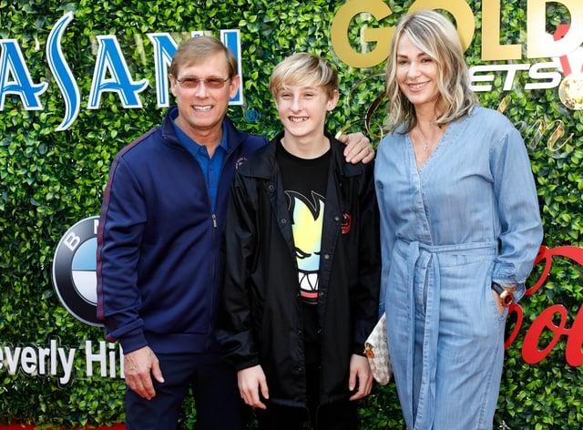 Host Nadia Comaneci alongside son Dylan and husband Bart Conner (PA Images)