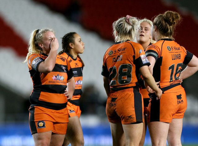 Castleford Tigers look dejected after losing the WSL final (PA Images)