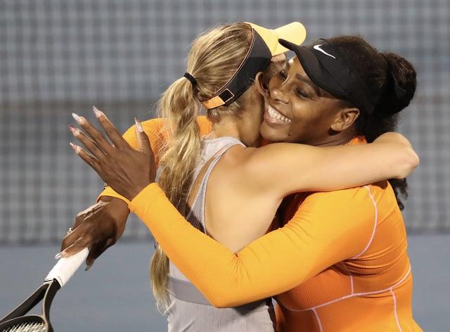 BFFs Williams and Wozniacki embrace on court (PA Images)