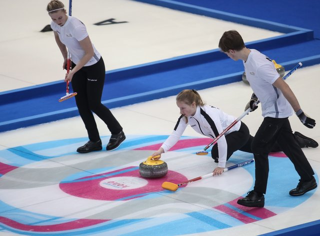 Nora Oestgaard, Lukas Hoestmaelingen and Ingeborg Forbregd on their way to Norway's gold in the mixed curling event (PA Images)