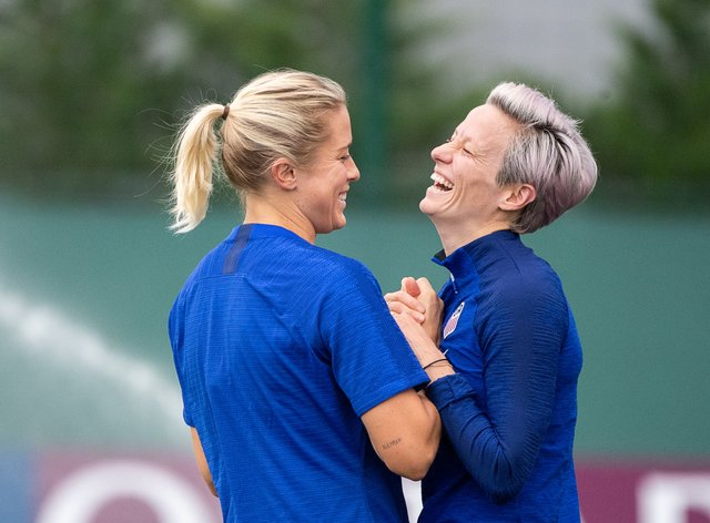 Julie Ertz (left) and Megan Rapinoe share a joke during the selection camp (PA Images)