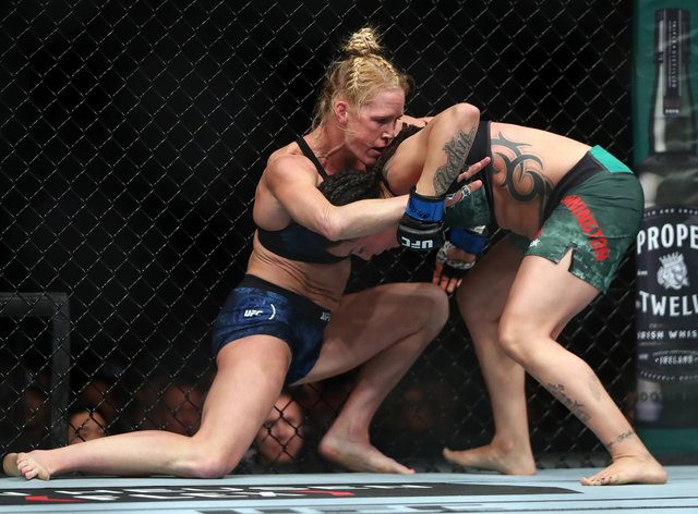 Holm and Pennington spent much of their fight in the clinch (PA Images)