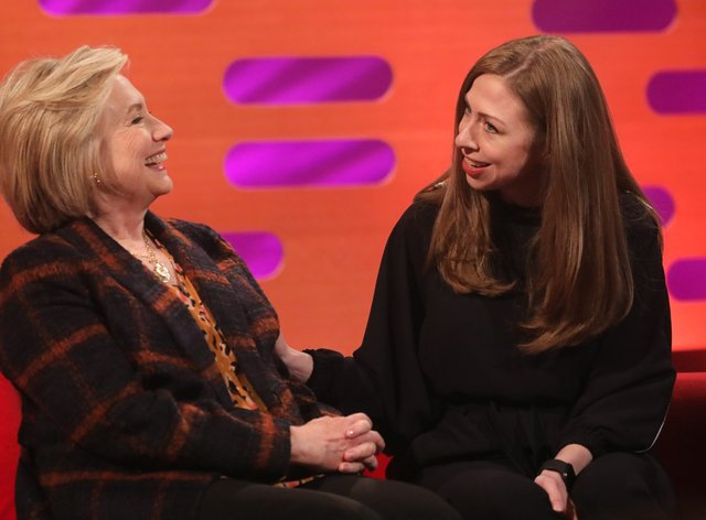 Author Chelsea Clinton, with her mother Hillary, has a new book on women sports stars coming out in May (PA Images)