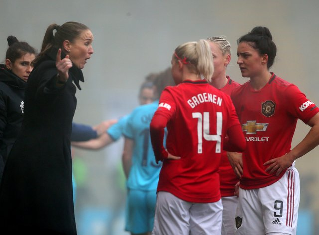 Casey Stoney with her Man Utd player (PA Images)