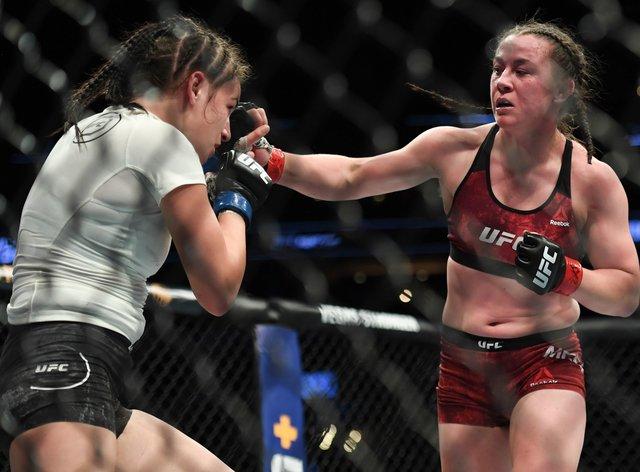 McCann (right) became the first English woman to win in the UFC in March 2019 (PA Images)