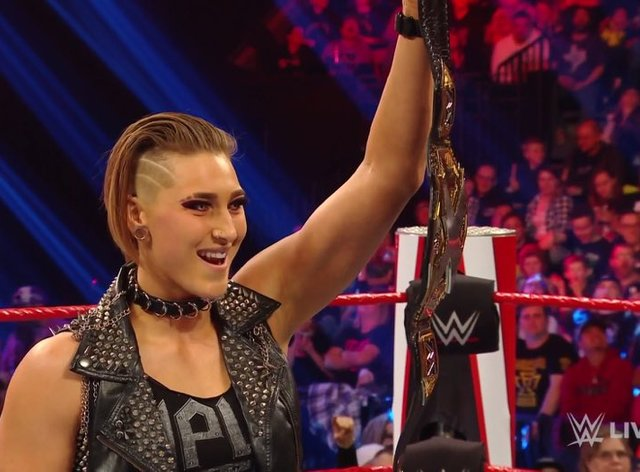 Rhea Ripley holds up her title as she challenges Charlotte Flair (Twitter: @IGRealityEraWWE)