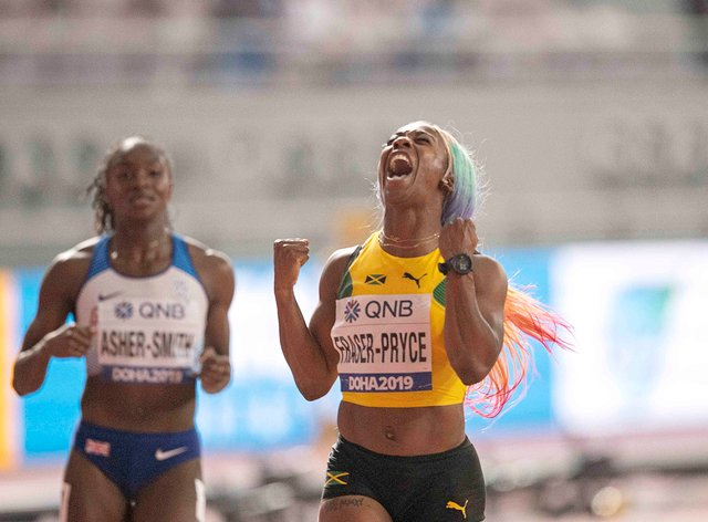 Fraser-Pryce beat Britain's Dina Asher-Smith to the 100m world title in Doha (PA Images)