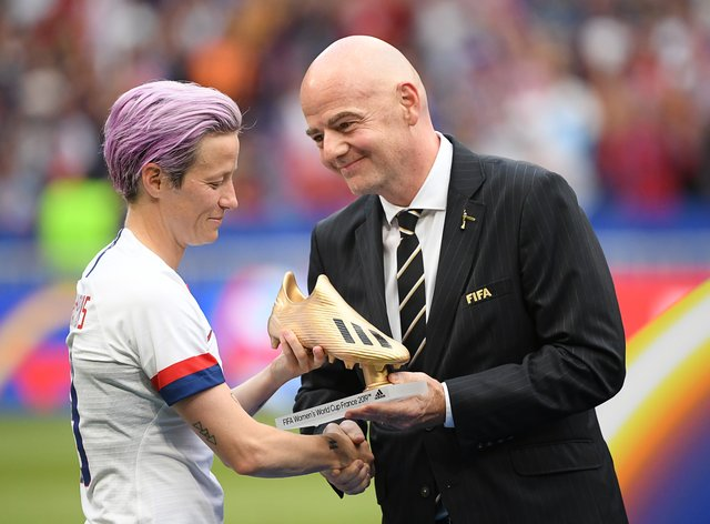 Infantino handing US star Megan Rapinoe her golden boot at the 2019 World Cup (PA Images)