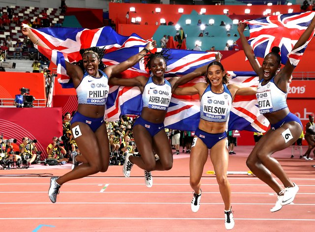 (L-R) Asha Philip, Dina Asher-Smith, Ashleigh Nelson, Daryll Neita celebrate their 4x100m silver in Doha (PA Images)