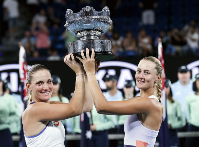 Mladenovic, right, says Babos, left, is her 'medicine' (PA Images)