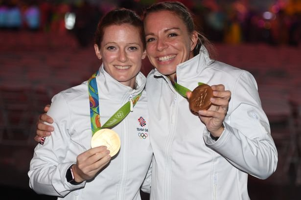Helen (left) and Kate Richardson-Walsh pose with their Olympic gold medals (katerichardson-walsh.com)