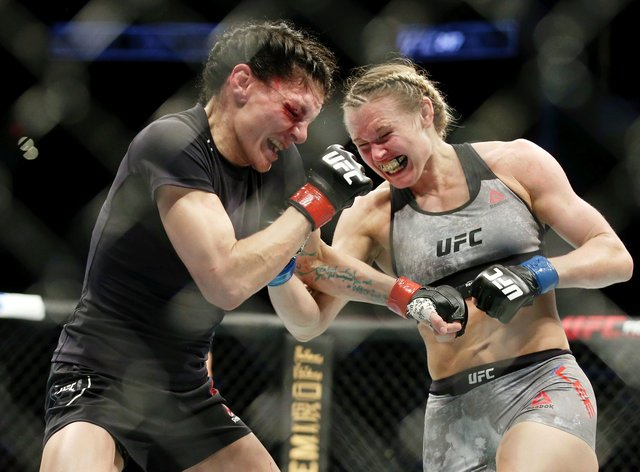 Lee (right) was distraught at her split decision loss at UFC 247 (PA Images)