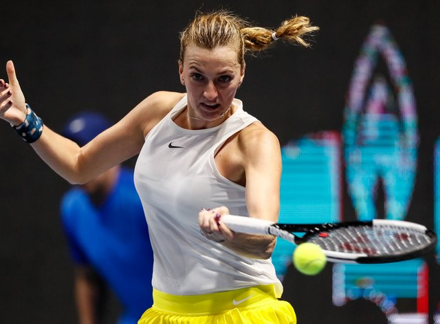 Petra Kvitova reached the quarter-finals after she beat Alison Van Uytvanck  7-6 (1), 1-6, 6-2 (PA Images)
