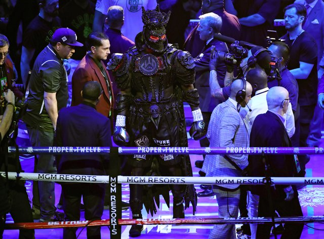 Wilder slowly made his way to the ring draped in his costume and mask (PA Images)