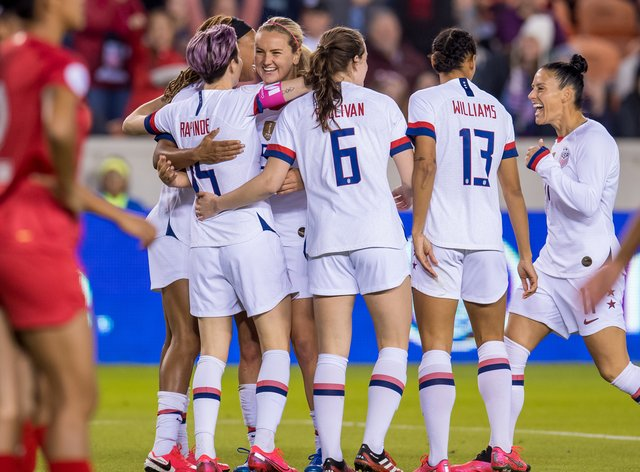 The US players celebrate winning the CONCACAF Olympic qualifying tournament (PA Images)