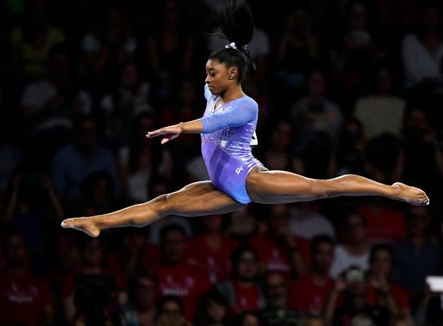 Biles is a 19-time world champion (PA Images)