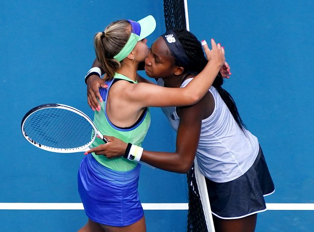 Gauff and Kenin embrace at the net in Melbourne (PA Images)