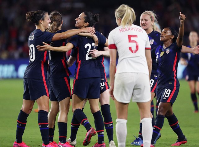 USA celebrate their second goal of the evening as England captain Steph Houghton looks on (PA Images)
