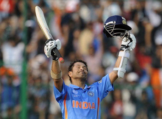 Tendulkar celebrates scoring a century on the way to India's 2011 World Cup victory (PA Images)