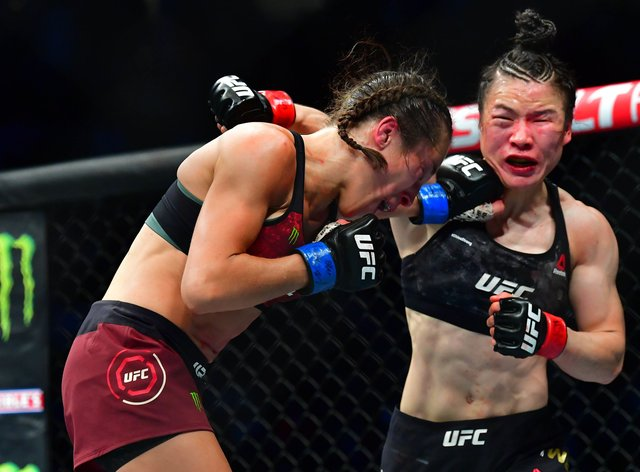 Zhang Weili and Joanna Jedrzejczyk were involved in a fight of the year contender on Saturday night (PA Images)