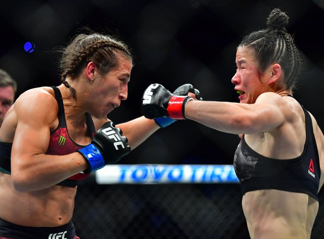 Joanna Jedrzejczyk (left) and Zhang Weili battled it out on Saturday night at UFC 248 (PA Images)