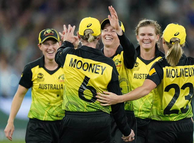 Mooney celebrates Australia's T20 World Cup win alongside her teammates (PA Images)