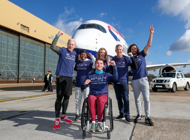 Iwan Thomas, Nicola Adams, Gabby Logan, Gary Lineker and Joe Wicks with Alfie Hewett (front), after taking part in an attempt to break the Guinness World Record for the heaviest 100m A350 plane pull during a Sport Relief event at Heathrow Airport (PA Images)
