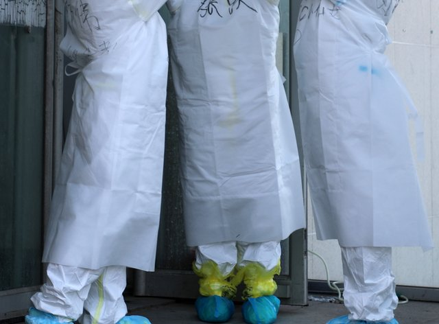 Scientists celebrate a day with no new domestic cases in China (PA Images)