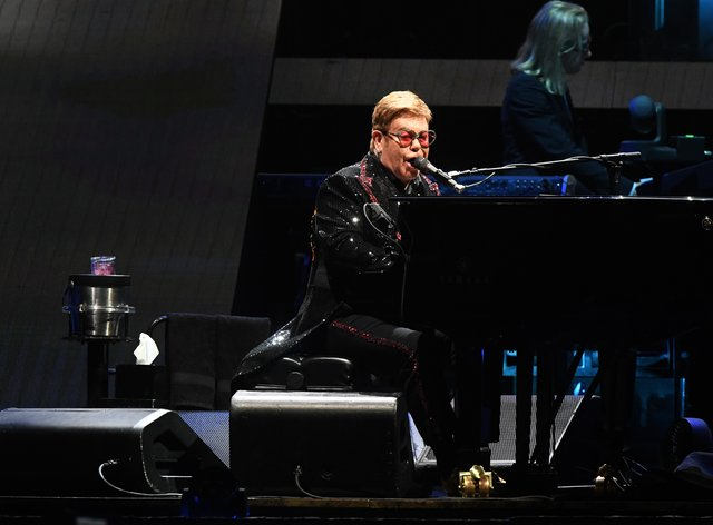 Sir Elton John is hosting the virtual gig with a host of big name contributors  (PA Images)