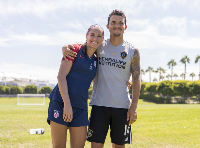 Alex Morgan with husband Servando Carrasco who will not be present at the birth of their first child due to hospital restrictions  (PA Images)
