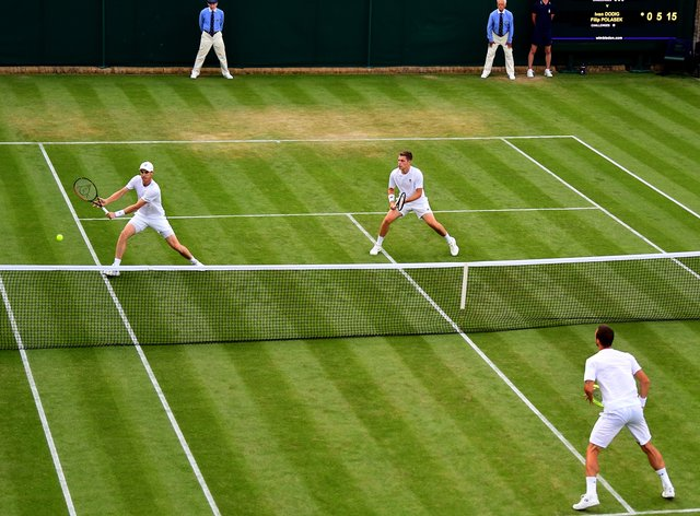 Jamie Murray (left) thinks this year's Wimbledon is likely to be cancelled (PA Images)