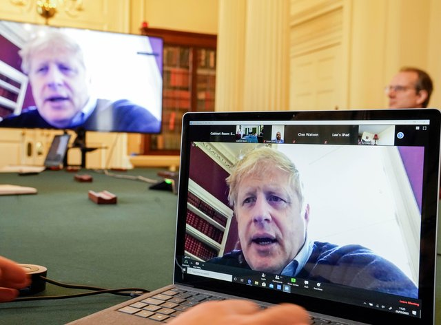 The Prime Minister has been chairing meetings via video link during his isolation (PA Images)