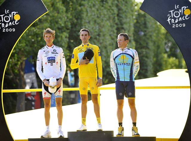 Contador (centre) won the 2009 Tour de France as Lance Armstrong (right) finished third (PA Images)