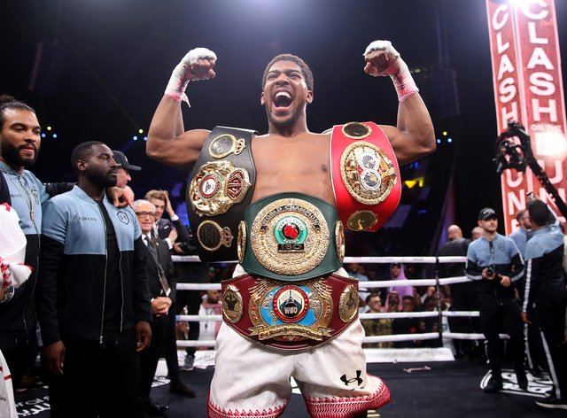 Joshua reclaimed his world heavyweight titles in Saudi Arabia in December (PA Images)