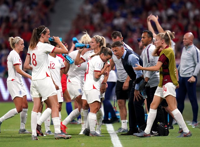 Neville with the players during the FIFA Women's World Cup semi final match at the Stade de Lyon (PA Images)