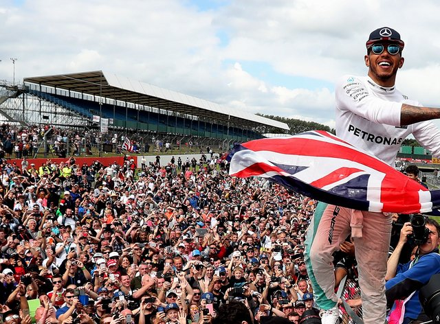 Lewis Hamilton will have to celebrate without his home fans should he win the race again this year (PA Images)